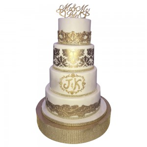 4 tier round gold mould and imprint wedding cake
