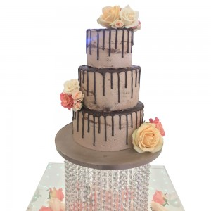 3 tier round chocolate drip wedding cake