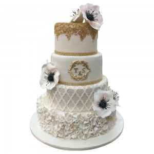 4 tier ivory and gold wedding cake