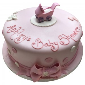 Baby shower cake with pram topper