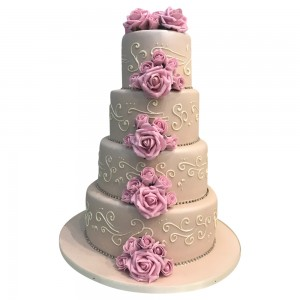 4 tier round ivory and pink wedding cake